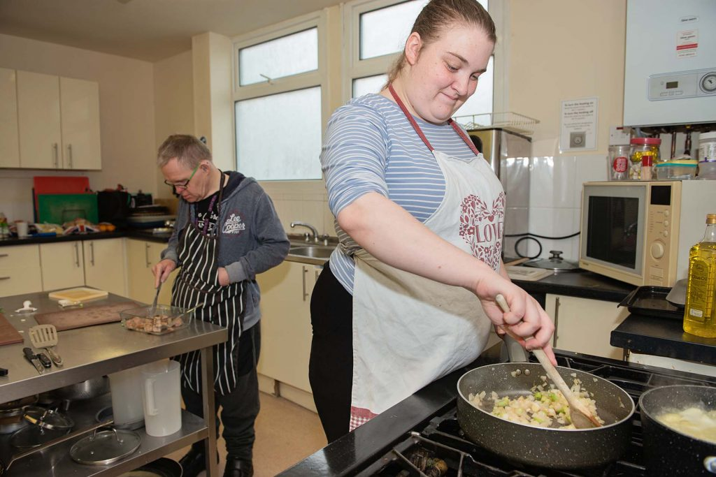 Shared living - cooking meals in the kitchen